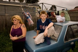 Maxine with her two sons Cody and Chase in their backyard, 2005