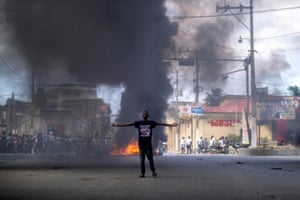 Man in front of burning tyres