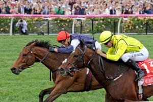 Almandin ridden by jockey Kerrin McEvoy leads the field to win the $6 million Melbourne Cup, followed by Heartbreak City, at Flemington Racecourse in Melbourne, Tuesday. Nov. 1, 2016.