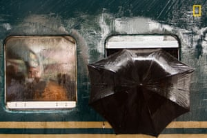 Umbrella poking out of a train
