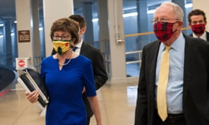 Susan Collins and Lamar Alexander make their way to the Senate chamber for a vote.