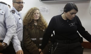 Ahed Tamimi is brought to a courtroom inside the Ofer military prison near Jerusalem.