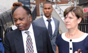 On trial: consultant David Sellu makes his first appearance at Hendon Magistrates Court accompanied by his wife and son in August 2012.