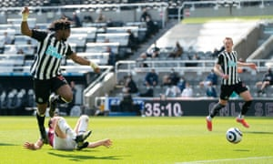 Newcastle's Allan Saint-Maximin, left, forces the games first goal as he shoots past West Ham's Mark Noble.