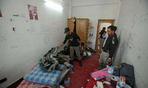Police search the dorm room of Mashal Khan.