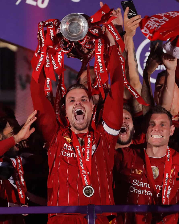 Jordan Henderson lifts the Premier League trophy.