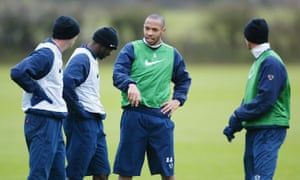 Thierry Henry (centre) talks to his Arsenal team-mates in training in April 2004.
