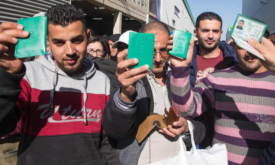 Sodastream employees show their Palestinian identity cards.