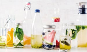 Make water more interesting by adding cucumber and mint or watermelon slices and blueberries.