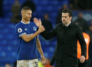 Richarlison shakes hands with manager Marco Silva after their 2-0 victory.