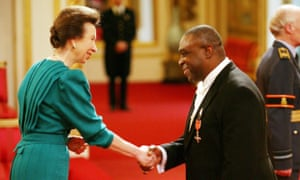 Adebayo receives an MBE from the Princess Royal in 2009.
