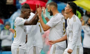Real Madrid's Karim Benzema celebrates scoring their second goal with Vinicius Junior and James Rodríguez.