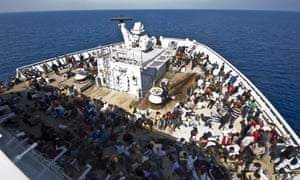 A rescue boat carries migrants to safety in the Mediterranean.