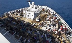 Rescued migrants onboard HMS Bulwark on 7 June.