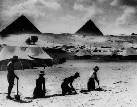 19th October 1939: Stripped to the waist, soldiers toil in the heat of the midday sun, in the shadow of the Egyptian pyramids.