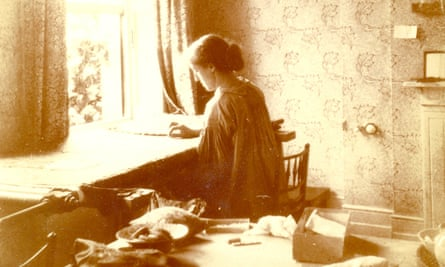 May Morris embroidering at home in Hammersmith, c.1920.