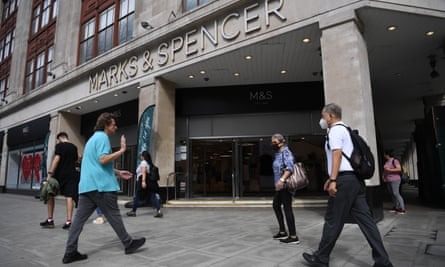 Shoppers outside a Marks & Spencer store in London