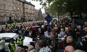 Crowds wait for the arrival of Boris Johnson outside Bute House.