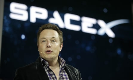 Elon Musk introducing the SpaceX Dragon V2 spaceship at the SpaceX headquarters in Hawthorne, California.