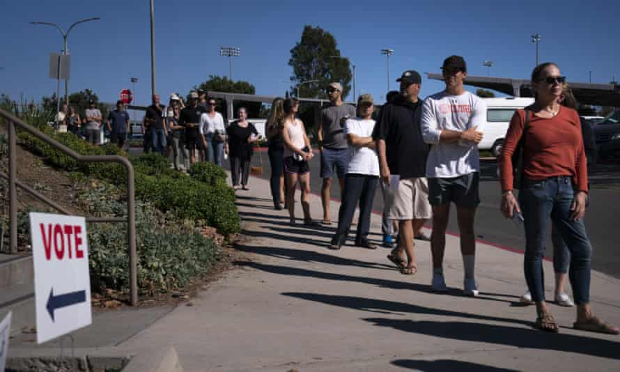 People wait in line to cast their ballots in Huntington Beach