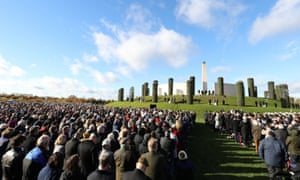 People attend a ceremony at the National Memorial Arboretum, Alrewas, Staffordshire.