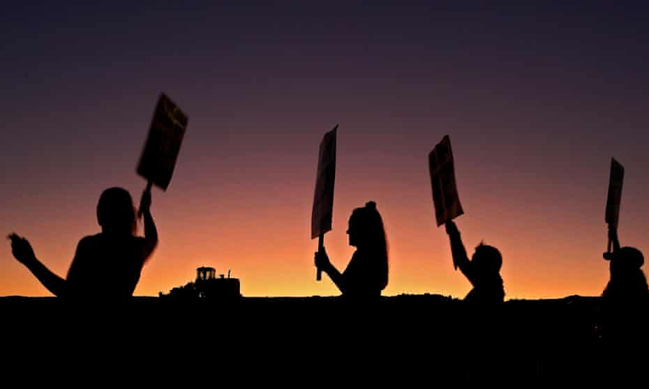 Members of the United Autoworkers picket outside the General Motors plant in Arlington, Texas.