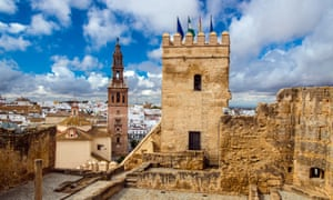 Carmona's Alcazar puerta de Sevilla (Seville Gate) with San Pedro church in background.