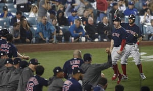 Brock Holt celebrates with his teammates after scoring the go-ahead run in the ninth inning