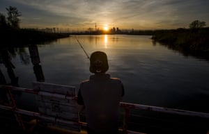 Hasan Mohammad fishes at Tommy Thompson Park in Toronto, Canada