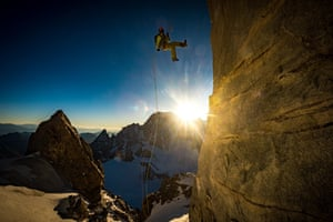 Honourable mention: Alex Buisse Chamonix, France Vivian Bruchez on the last freehanging abseil from Dent du Géant, as the sun sets over Mont Blanc