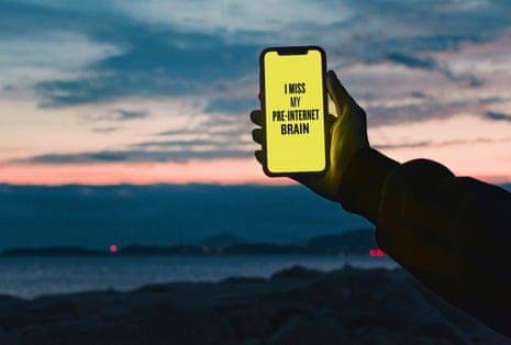"Picture of a person holding a mobile phone with the message on it saying ""I miss my pre-internet brain"" from Douglas Coupland's series Slogans for the 21st Century"