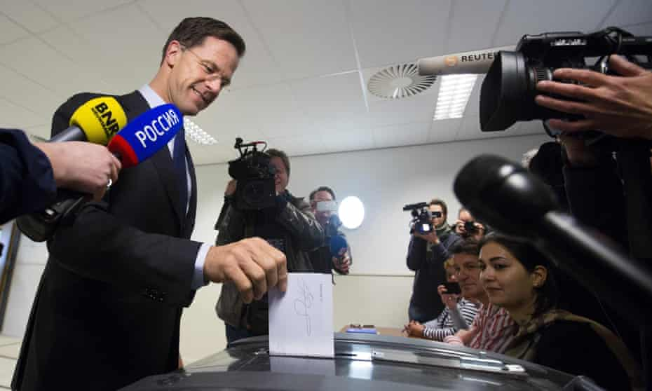 Dutch prime minister Mark Rutte casts his vote in the referendum in The Hague.