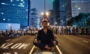 A protester blocks Harcourt Road