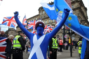 Pro-Scottish independence activists march through the streets of Glasgow