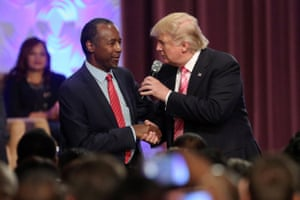 Donald Trump shakes hands with Dr. Ben Carson.