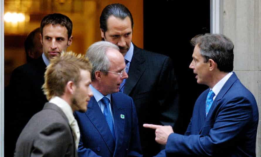 Gareth Southgate, David Seaman and David Beckham watch Sven-Göran Eriksson talk to Tony Blair at 10 Downing Street on the day the Swede had named his 2002 World Cup squad