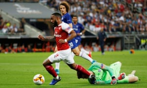 Arsenal's Alexandre Lacazette goes down after challenging Chelsea keper Kepa Arrizabalaga for the ball.