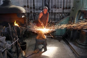 Kippa Matthews's image of Phil Beckwith, a wrought iron worker, forging spikes in the workshop at Tholthorpe, near York, 2005.