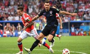 Dejan Lovren wins the ball from Fedor Smolov during Croatia's quarter-final win against Russia on Saturday.