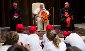 Pope Francis holding the life jacket of a young victim drowned in the Mediterranean sea trying to reach Europe.