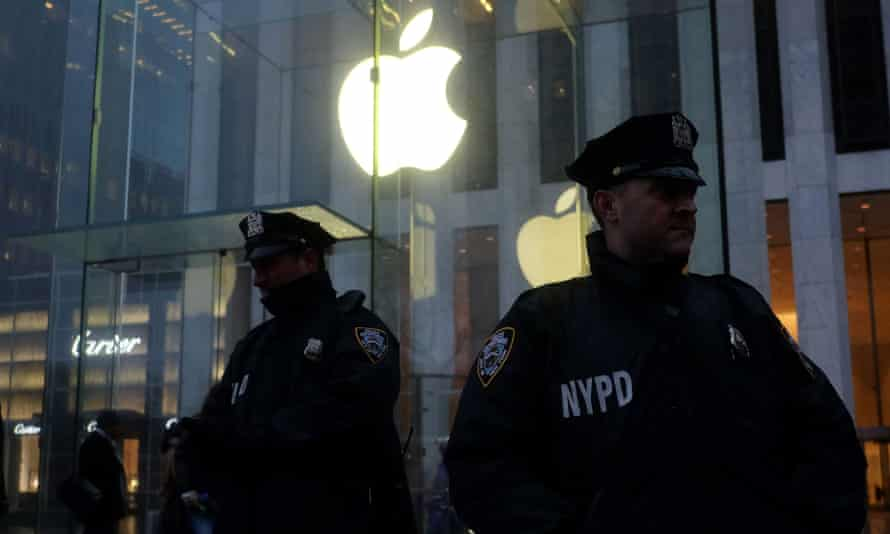 New York police officers on guard outside the New York Apple Store