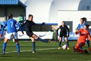 Caroline Weir of Man City scores the first goal.