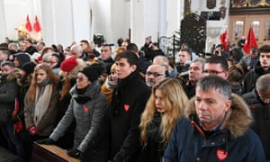 Mourners attend a funeral ceremony for Paweł Adamowicz