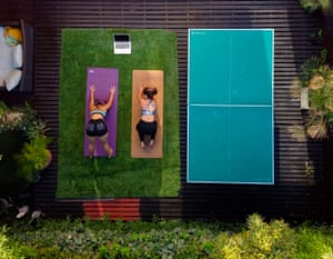 Two women practising yoga while on lockdown at home in Santiago, Chile.