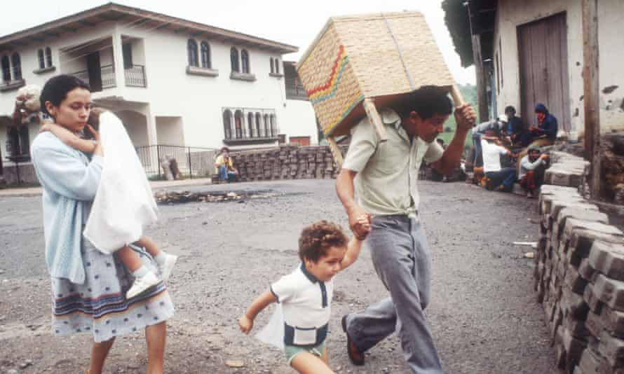 Refugees walk past barricades on 1 July 1979 in Nicaragua.