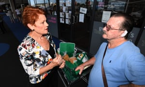 One Nation leader Senator Pauline Hanson talks to a Queenslander last March, six months before One Nation saw its vote collapse in the state election.