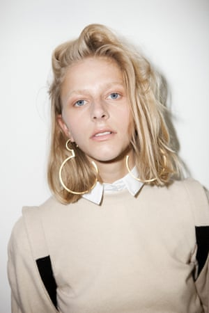 white shirt Cos, beige and dark brown jumper Matches, gold hoop earrings Jenny Sweetnam