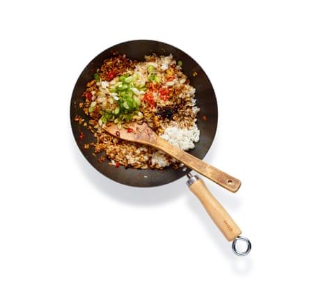 Felicity Cloake Nasi Goreng 05. Stir in the paste, then the rice, breaking it up as you do so. Add the soy, spring onion and chilli, and stir-fry.