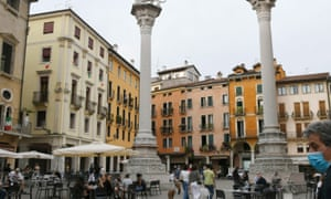 People sit outside in a cafe in Vicenza as Italy gradually eases lockdown measures.