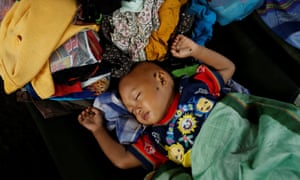 A child rests at an evacuation centre at Labuhan after a tsunami hit Banten province in Indonesia.